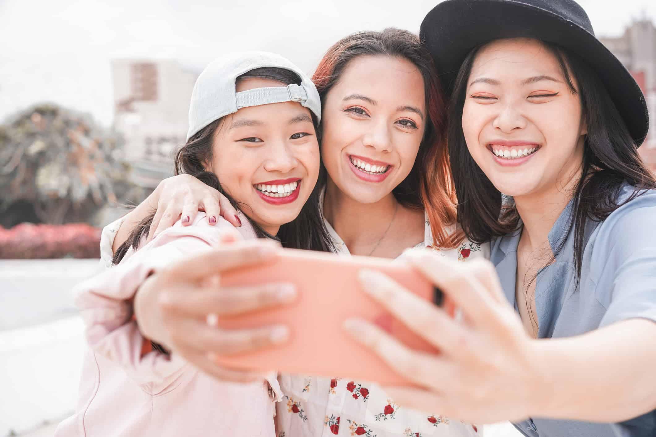 Trendy Asian Girls Making Video Story For Social Network App